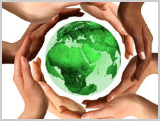 Diverse hands holding a green globe
