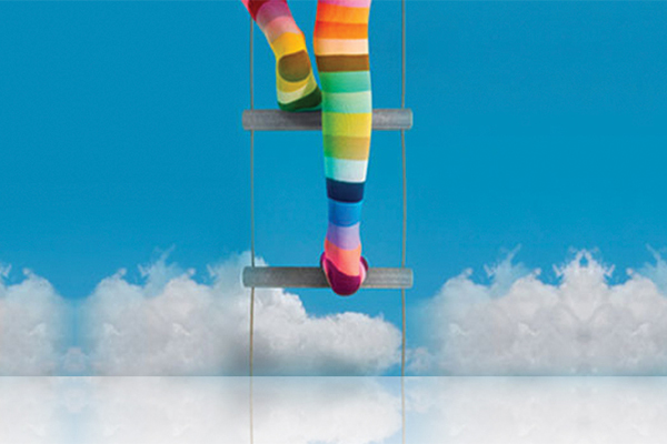 Woman in rainbow tights climbing a ladder in the sky