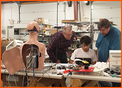 IEEE Eastern North Carolina members working on their Ken Android project.